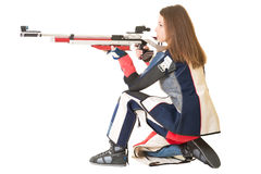 Woman training sport shooting with air rifle gun. In studio Royalty Free Stock Image