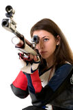 Woman training sport shooting with air rifle gun. In studio Stock Photography