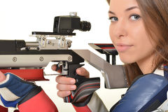 Woman training sport shooting with air rifle gun Royalty Free Stock Images