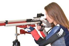 Woman training sport shooting with air rifle gun Royalty Free Stock Photo