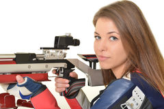 Woman training sport shooting with air rifle gun Royalty Free Stock Image