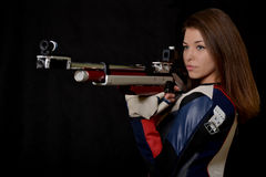 Woman training sport shooting with air rifle gun Royalty Free Stock Photos