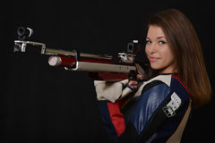 Woman training sport shooting with air rifle gun Stock Image