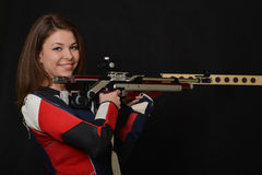Woman training sport shooting with air rifle gun Stock Images
