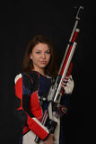 Woman training sport shooting with air rifle gun Stock Photography