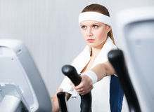 Woman training on training apparatus in gym Royalty Free Stock Photography