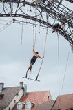 Woman training on trapeze for an outdoor aerobatics show in the main place of Mulhouse Royalty Free Stock Photos