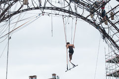 Woman training on trapeze for an outdoor aerobatics show in the main place of Mulhouse Stock Photo