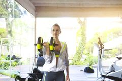 Woman training on a treadmill in a sport centre. Healthy woman training on a treadmill in a sport centre stock image