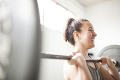 Woman training with weight bar stock photos