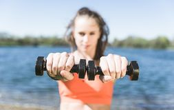 Woman training with weights Stock Photography