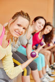 Woman training with weights Royalty Free Stock Image