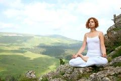 Woman training yoga Stock Photos