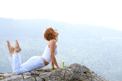 Woman training yoga Royalty Free Stock Image
