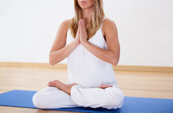 Woman training yoga at the gym Stock Photo