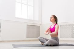Woman training yoga in lotus pose, copy space Royalty Free Stock Image