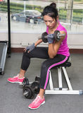 Woman trains with dumbbells Stock Images