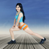 Woman trains her legs muscle Royalty Free Stock Images