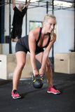 Woman trains with kettlebell in fitness gym Royalty Free Stock Photography