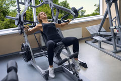 Woman Trains Pecs In The Gym Royalty Free Stock Image