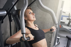 Woman trains pectoral muscles Stock Photos