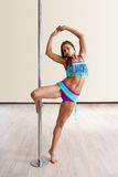 Woman traning pole dance Stock Images