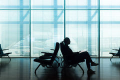 Woman in transit waiting on airport gate. Stock Photography