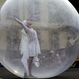 Woman in a transparent ball. AURILLAC, FRANCE- AUGUST 18: Aurillac International Street Theater Festival, Cie Jimyprod,an artist is dancing in a transparent ball royalty free stock images