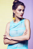 Woman in transparent blue dress and yellow earrings Stock Photos