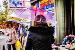 Woman With Transparent Umbrella Walking In A Rainy Day Royalty Free Stock Photography
