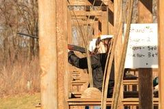 Woman trap shooting range Royalty Free Stock Photos
