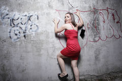 Woman trapped against a wall Royalty Free Stock Image