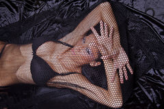 Woman Trapped In Black Fishnet Royalty Free Stock Images