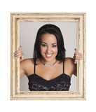 Woman trapped in frame. Royalty Free Stock Image