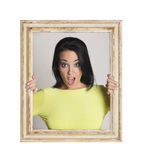 Woman trapped in frame. Stock Image