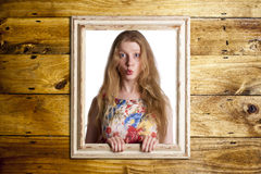 Woman trapped in frame. Royalty Free Stock Photography