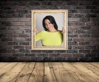 Woman trapped in frame. Stock Photos
