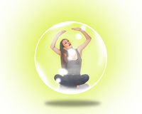 Woman trapped inside a soap bubble. Stock Photography