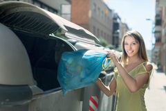 Woman with trash bags near garbage bin Royalty Free Stock Photography