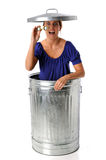 Woman in Trash Can With Binoculars Royalty Free Stock Image