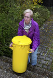 Woman with trashcan Stock Image