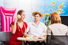 Woman in travel agency with shell listening Stock Photography