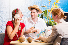 Woman in travel agency shell to shell. Happy Woman in travel agency shell to shell Stock Images