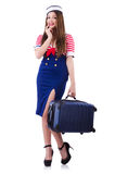 Woman travel attendant with suitcase. On white Stock Photo