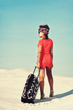 Woman with travel bag. Beautiful woman with travel bag in desert Stock Photo