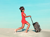 Woman with travel bag. Beautiful woman with travel bag in desert Royalty Free Stock Photography
