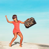 Woman with travel bag. Beautiful woman with travel bag in desert Stock Photography