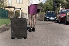 Woman with travel bag on the street, getting ready for jorney.  Royalty Free Stock Photography