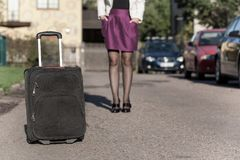 Woman with travel bag on the street, getting ready for jorney.  Royalty Free Stock Image
