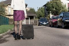 Woman with travel bag on the street, getting ready for jorney.  Royalty Free Stock Images